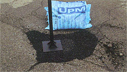 Image: Tamping Pothole Patch