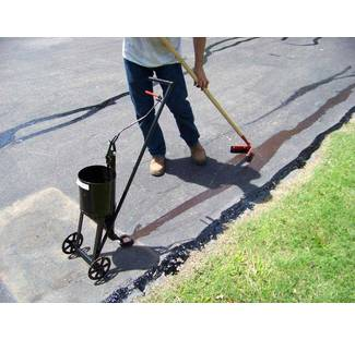 Image:  Asphalt Crack Filling Using Wheeled Pour Pot And Squeegee