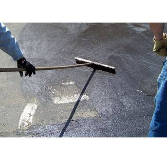 image: Applying Asphalt Emulsion Driveway Sealer With A Squeegee