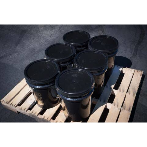 Pallet showing 6 buckets of BIGA Asphalt Emulsion Sealer