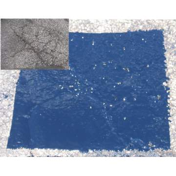 image of the QuickHold product used as an asphalt patch